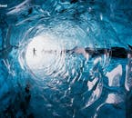 Add to the adventure and explore a mystical blue ice cave inside of Iceland's many glaciers.