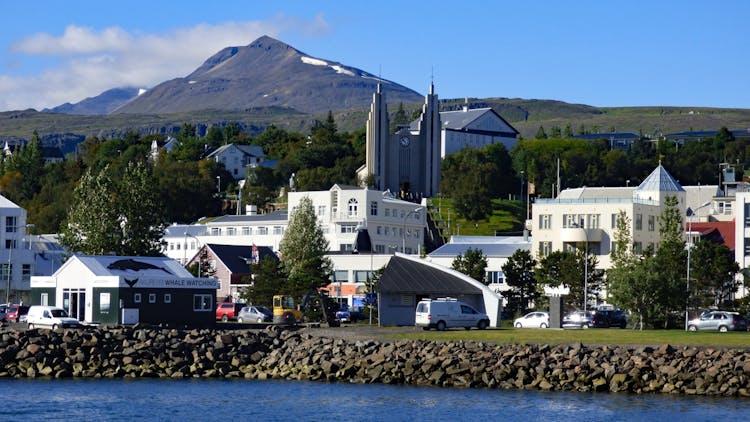 The town of Akureyri with the sharp Súlur peak high above.