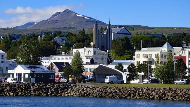 The town of Akureyri with the sharp Súlur peak high above.