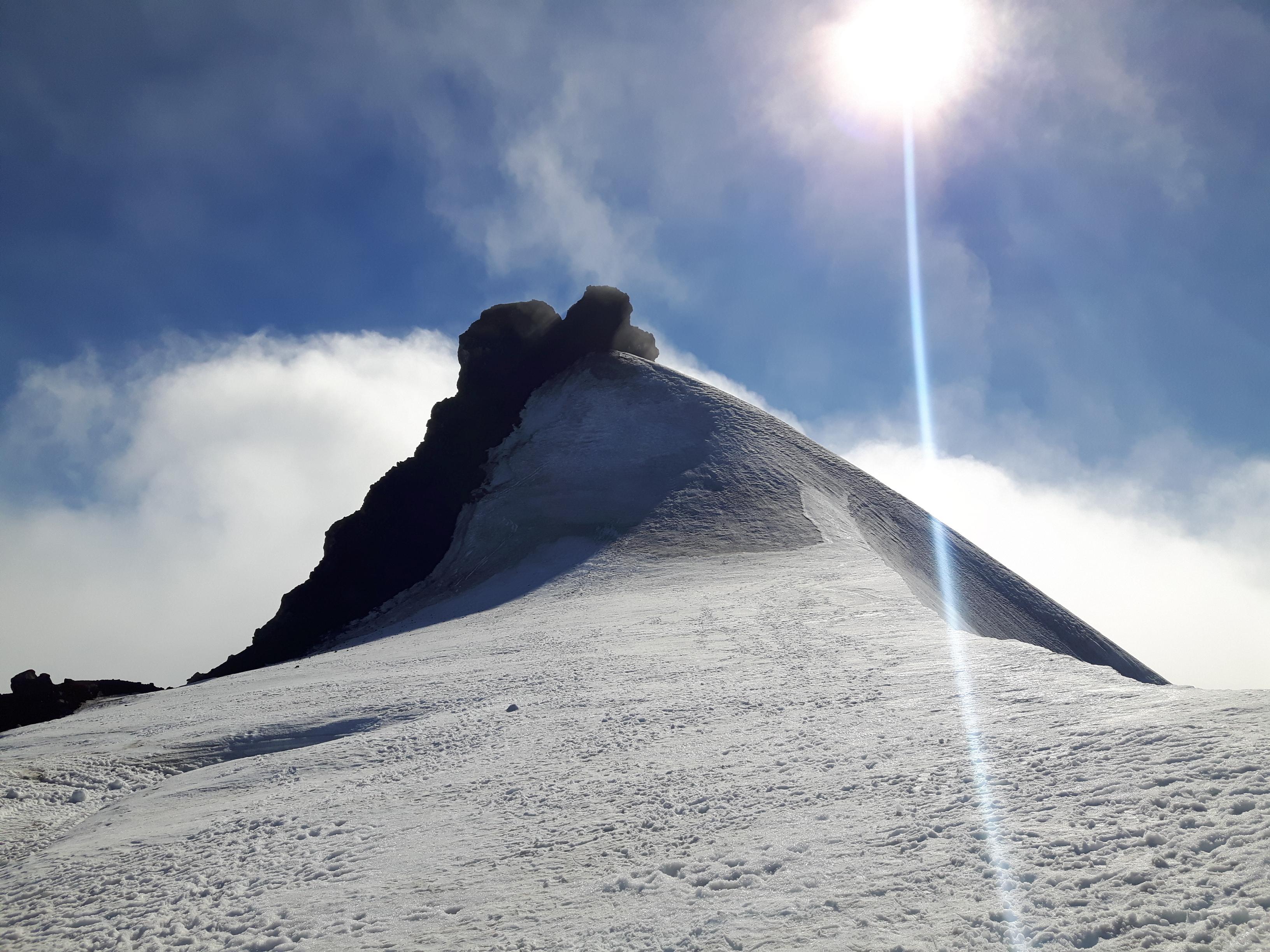 The peak of Snæfellsjökull glacier in the clouds.