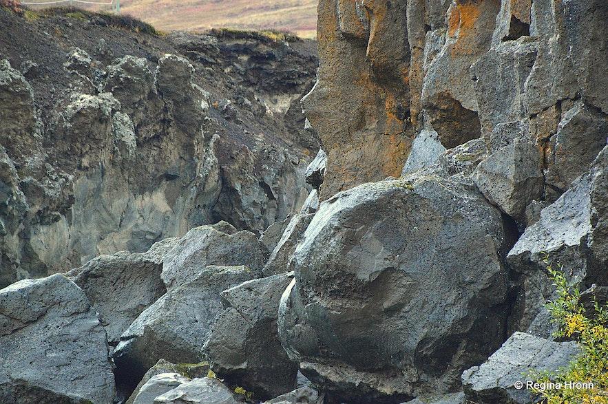 Rocks by the level of the river Skjálfandafljót on the east bank of Goðafoss waterfall