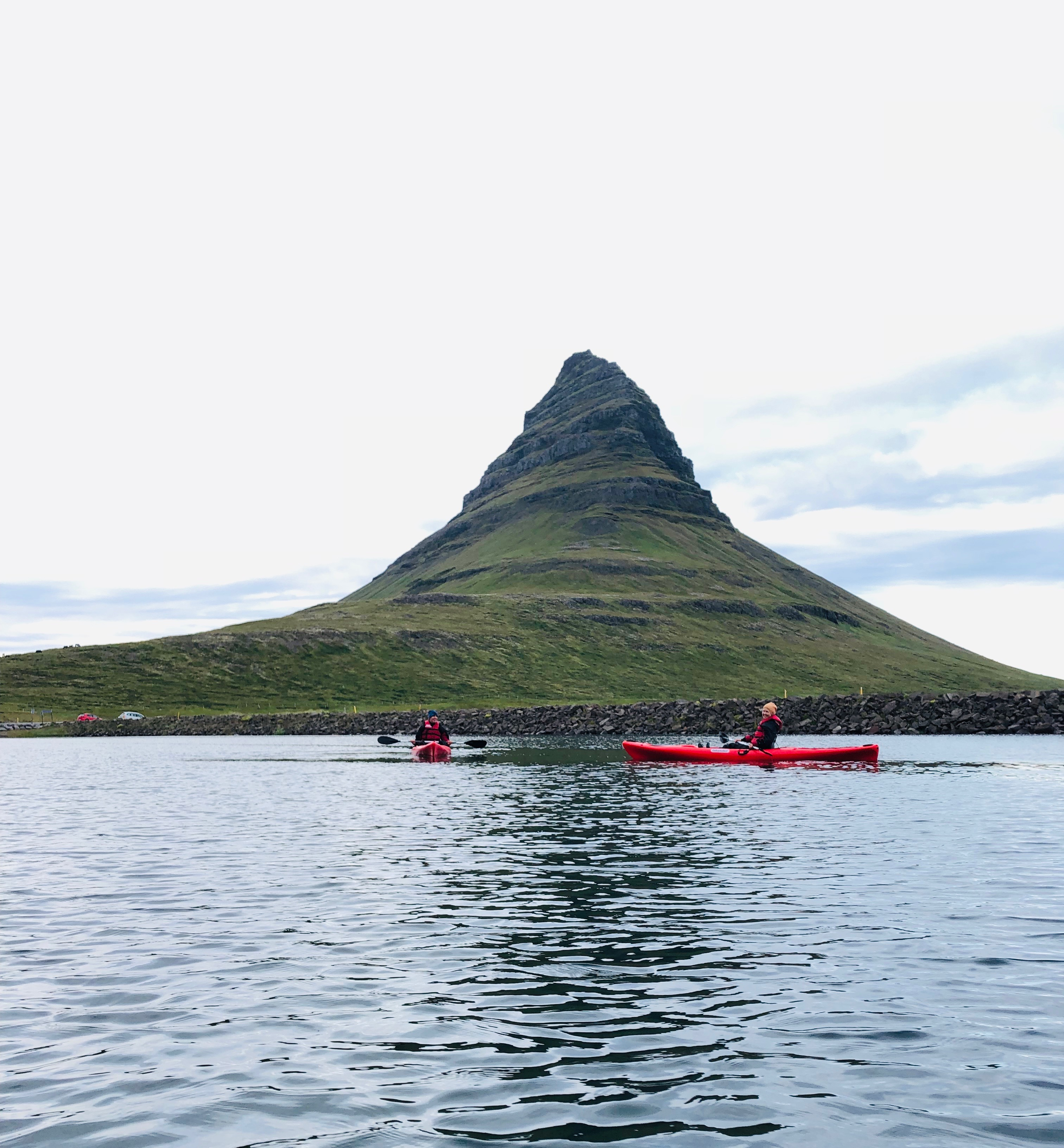 Kirkjufell Mountain is seen in the background as kayakers happily enjoy the tour