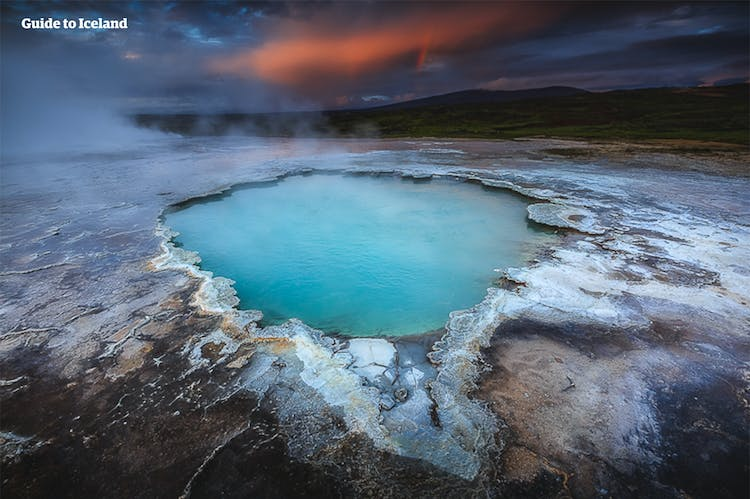 A steaming hot spring found in a geothermal area near Lake Mývatn.
