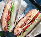 Enjoy a range of sandwiches and other meals at the restaurant at the Geosea sea baths.