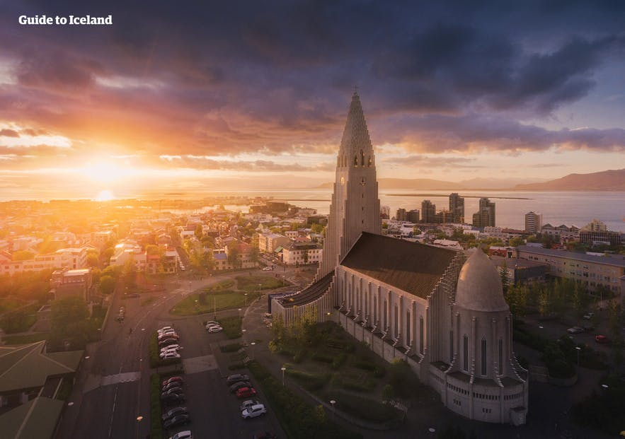 The capital city of Iceland, Reykjavik, pictured under the midnight sun from an aerial perspective.