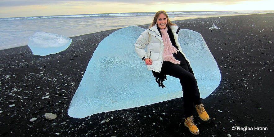Regína chilling on an iceberg at the ice diamond beach Breiðamekrursandur