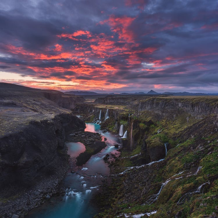 Iceland's highlands are decorated with patches of snow and river system.