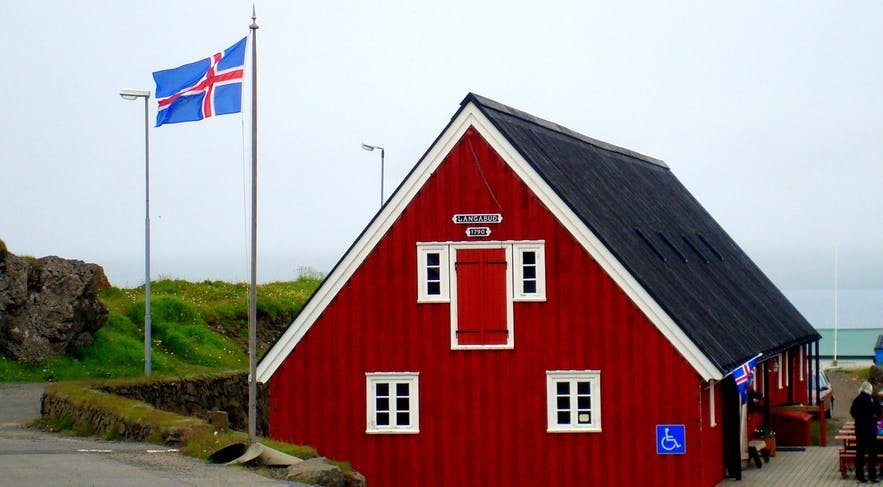 The Icelandic flag waves in the East Fjords.