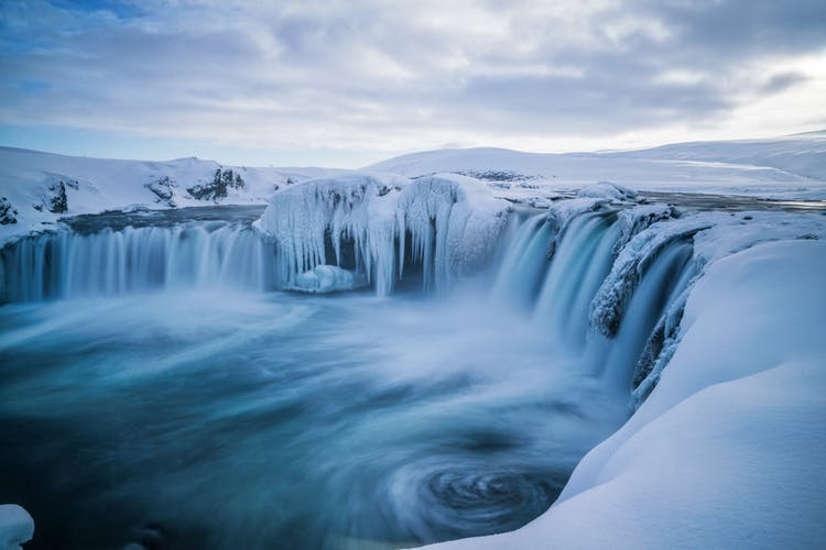 The stunning Goðafoss waterfall blanketed in snow.