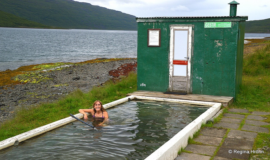 Regína soaking in Hörgshlíðarlaug swimming pool in the Wesfjords