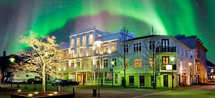 The aurora shining over the hotel in the winter.