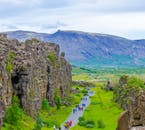 The North American tectonic plate towers over guests in Þingvellir National Park, Iceland.