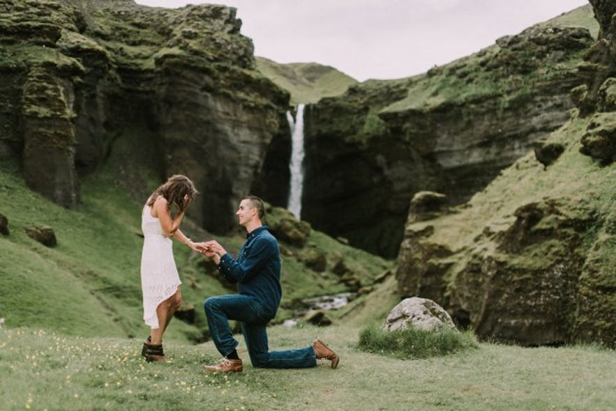 A marriage proposal in front of Icelandic waterfall.
