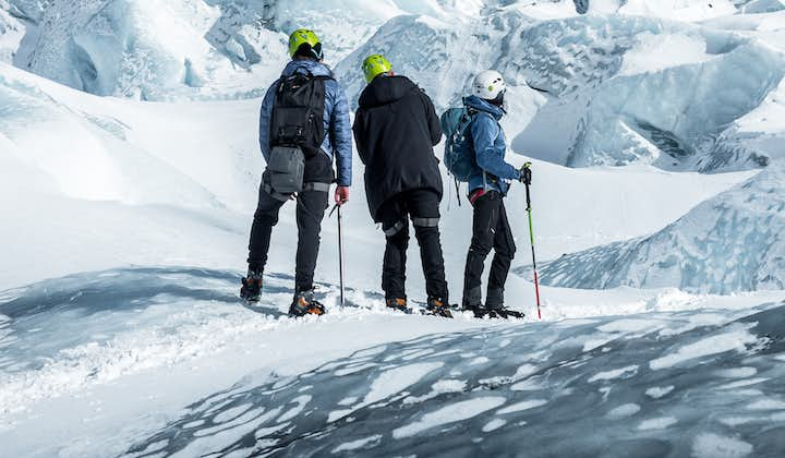 A group of people gearing up for a glacier hike in Iceland