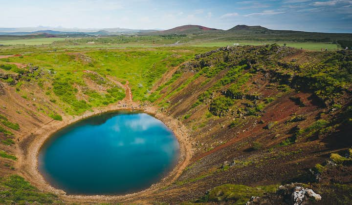 A crater lake with blue water
