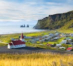 The gorgeous village of Vík look out to the sea and the Reynisdrangar sea stacks.