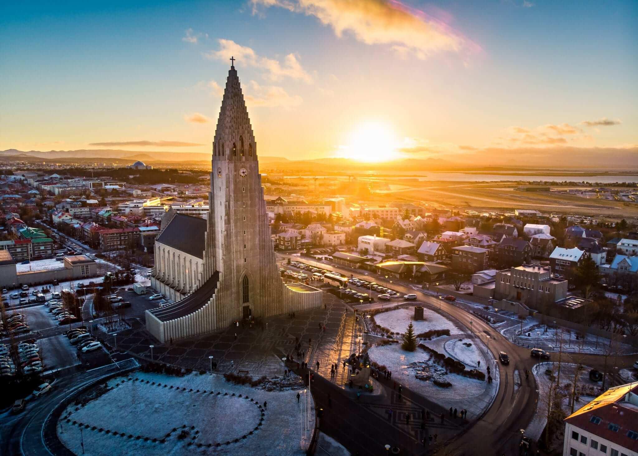 The Midnight Sun shines behind one of Iceland's most famous monuments, Hallgrímskirkja church.
