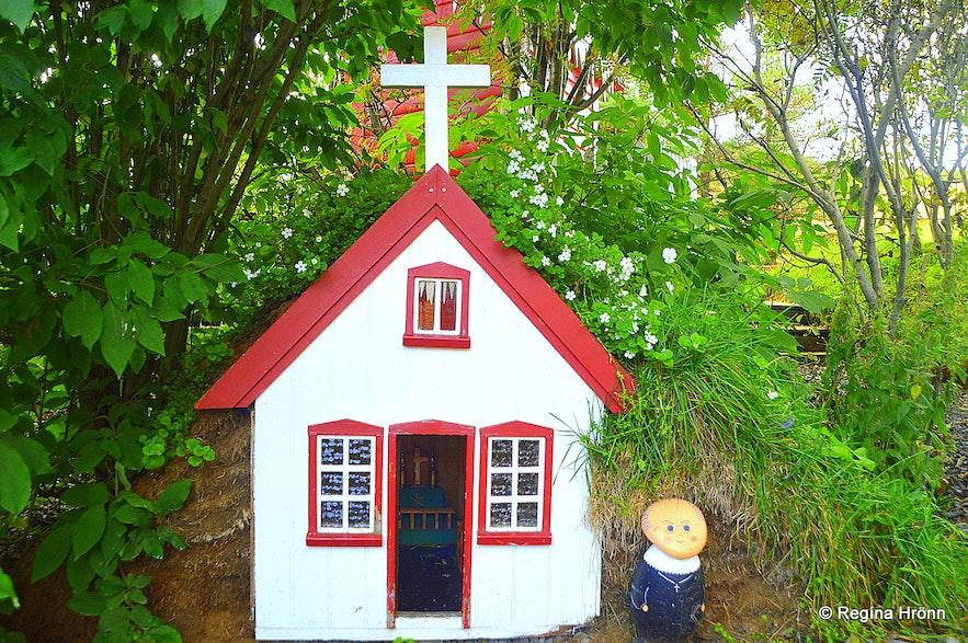 A miniature replica of a turf church in the garden of Jólahúsið