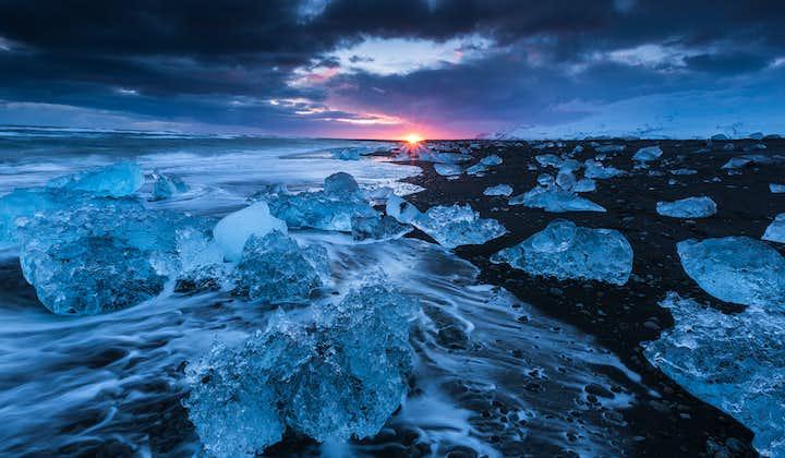 Icebergs glittering as the sun sets on the Diamond Beach near Jökulsárlón Glacier Lagoon.