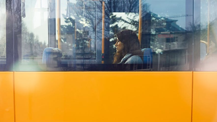 A woman riding the bus in Reykjavik
