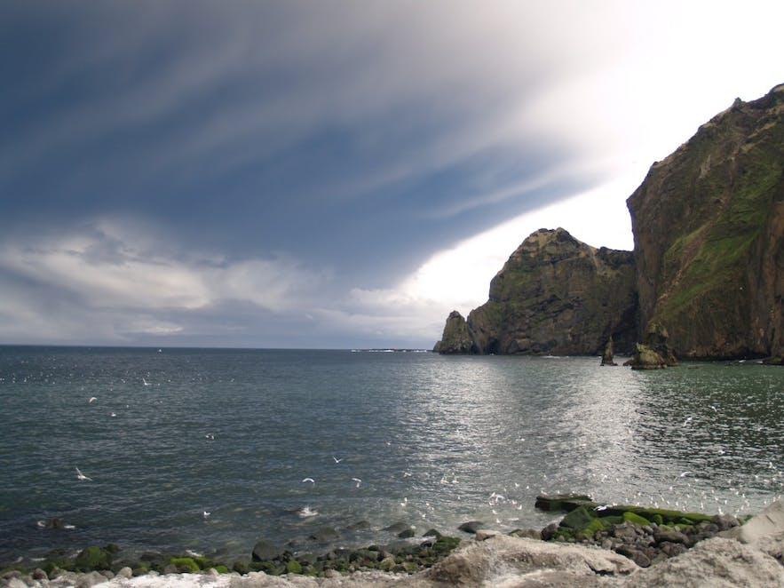 The Eyjafjalljokull eruption spewing ash beside Heimaey