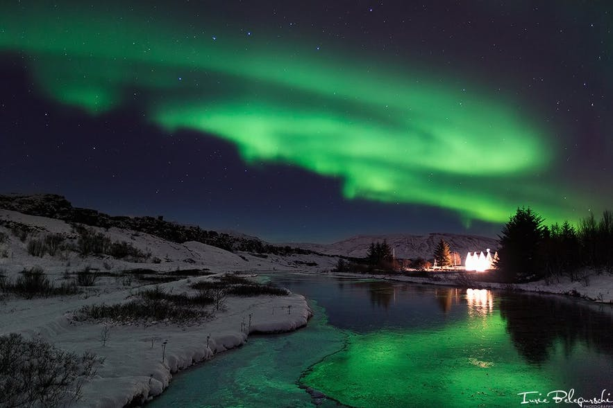Northern lights reflect beautifully in the waterways that cut through Þingvellir National Park.