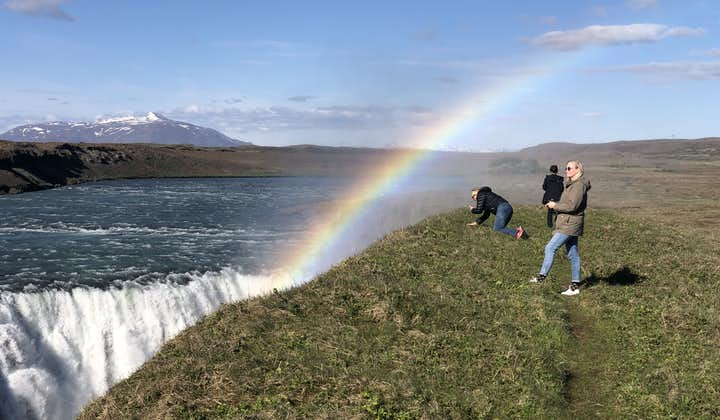 A rainbow forms on the east side of Gullfoss