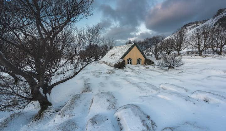 The Hofskirkja turf church in Iceland's east under blankets of winter snow