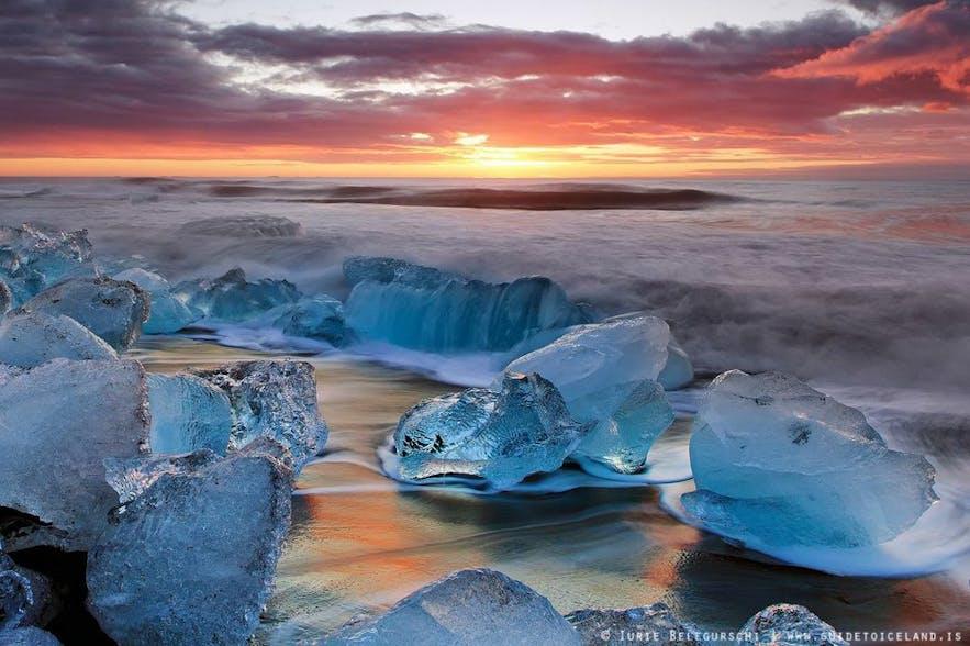 The beach by Jokulsarlon glacier lagoon often has ice floating towards the sea