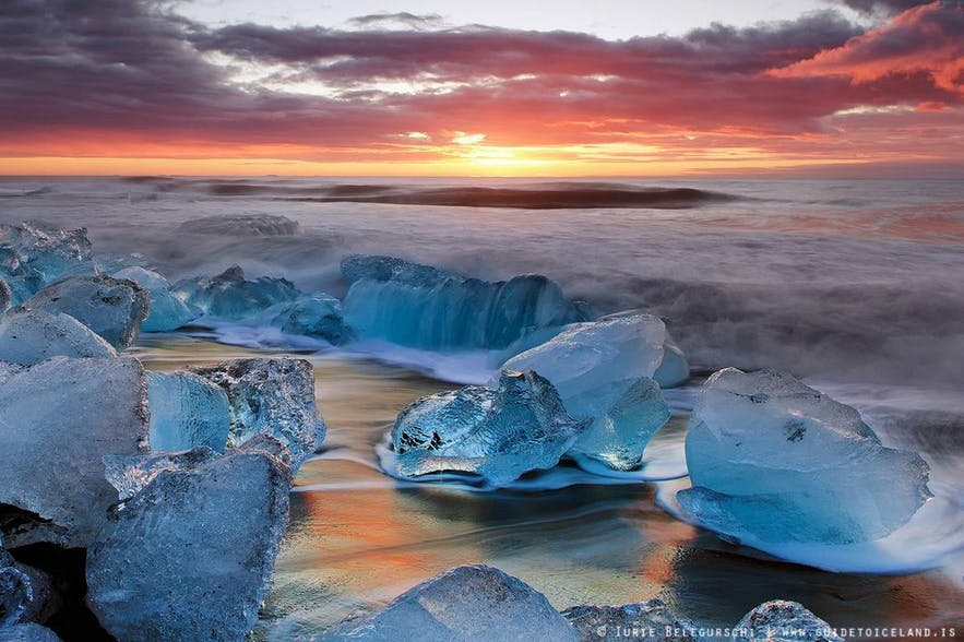 The beach by Jokulsarlon glacier lagoon often has ice floating towards the sea