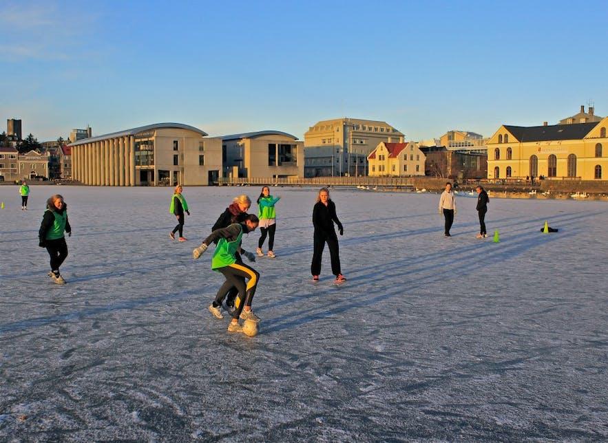 football on a frozen pond in Reykjavik by Ingólfur Shahin
