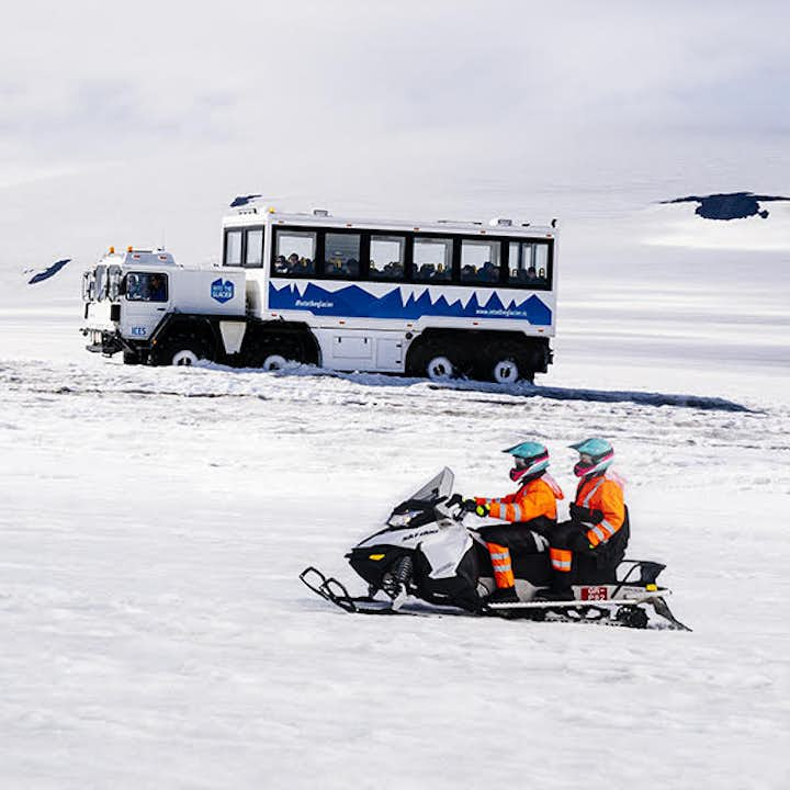 Incredible Into the Glacier Ice Tunnel Tour with Snowmobiling on Langjokull & Transfer from Husafell