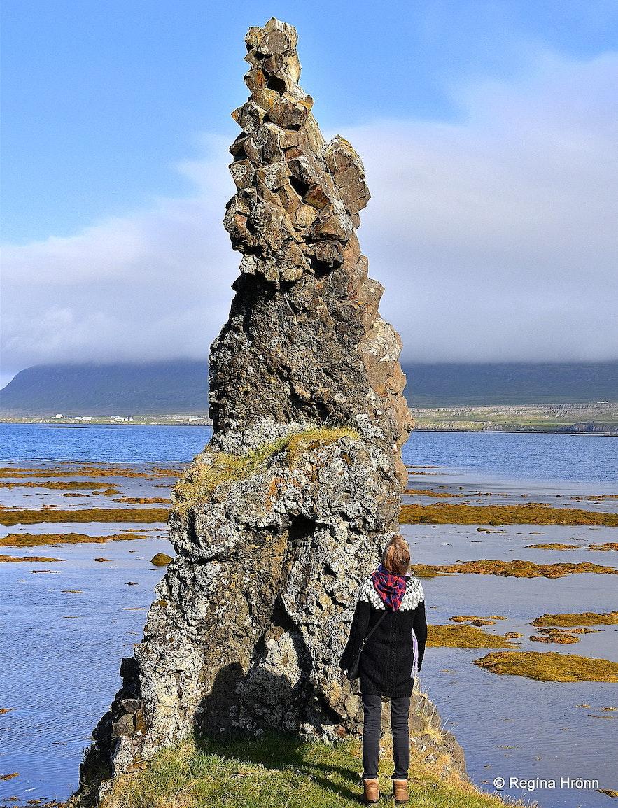 Regína in front of trolls in Iceland