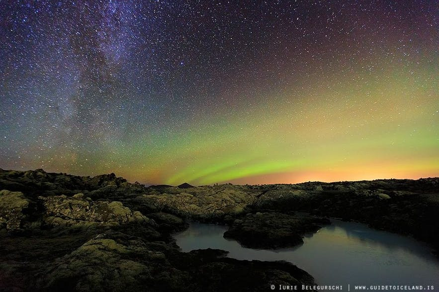 A rainbow of the auroras arch over Þingvellir National Park.