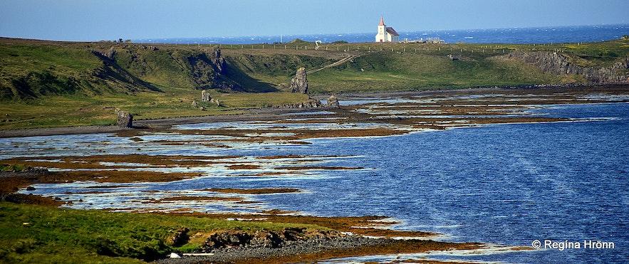 Kollafjarðarneskirkja church in the distance and the 2 trolls