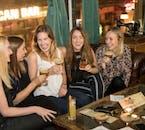 A group enjoy drinks on a pub crawl tour in Reykjavik