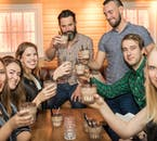 A happy group toasts to the Reykjavik Bar Crawl, cheers!