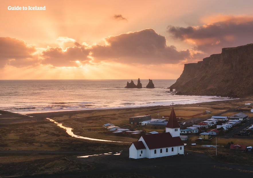 Church in Vik overlooking Reynisdrangar at sunset