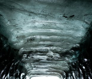 Snowmobile and Ice Cave on Langjokull Glacier from Gullfoss