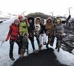 A tour group having a fun filled glacier hike on Solheimajokull glacier
