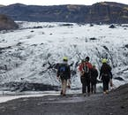 An excited tour group approaching Solheimajokull glacier