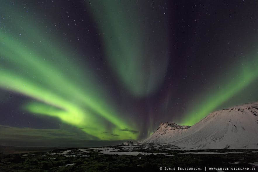 Bright green Northern Lights with hues of red and pink