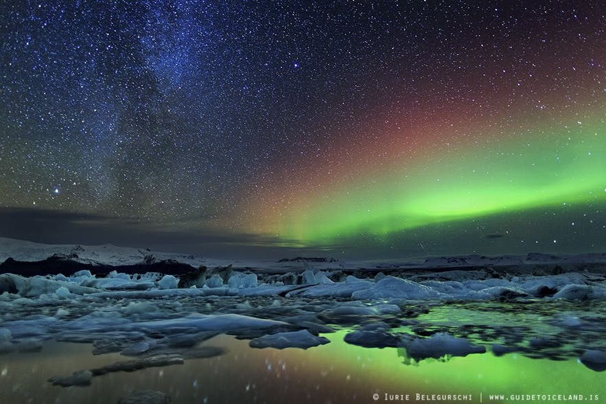 A beautiful shot of the Northern Lights dancing above the Jökulsárlón glacier lagoon on the island's South Coast.