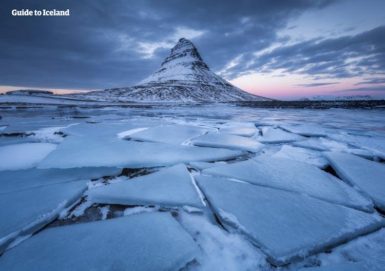 Kirkjufell mountain stands defiant over the township of Grundarfjörður.