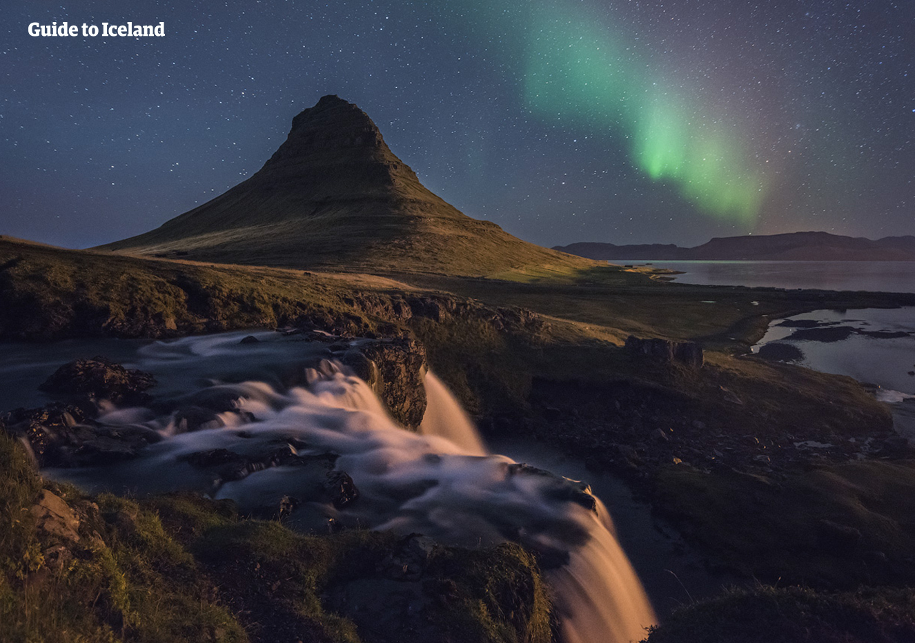 Kirkjufell is a beautiful mountain in west Iceland, shaped like a pyramid or arrow head.