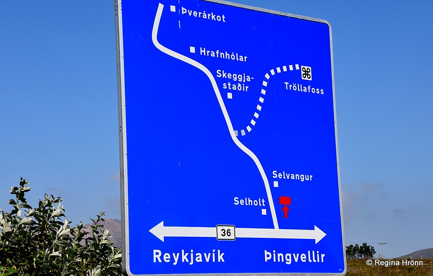 Road sign leading to Tröllafoss waterfall