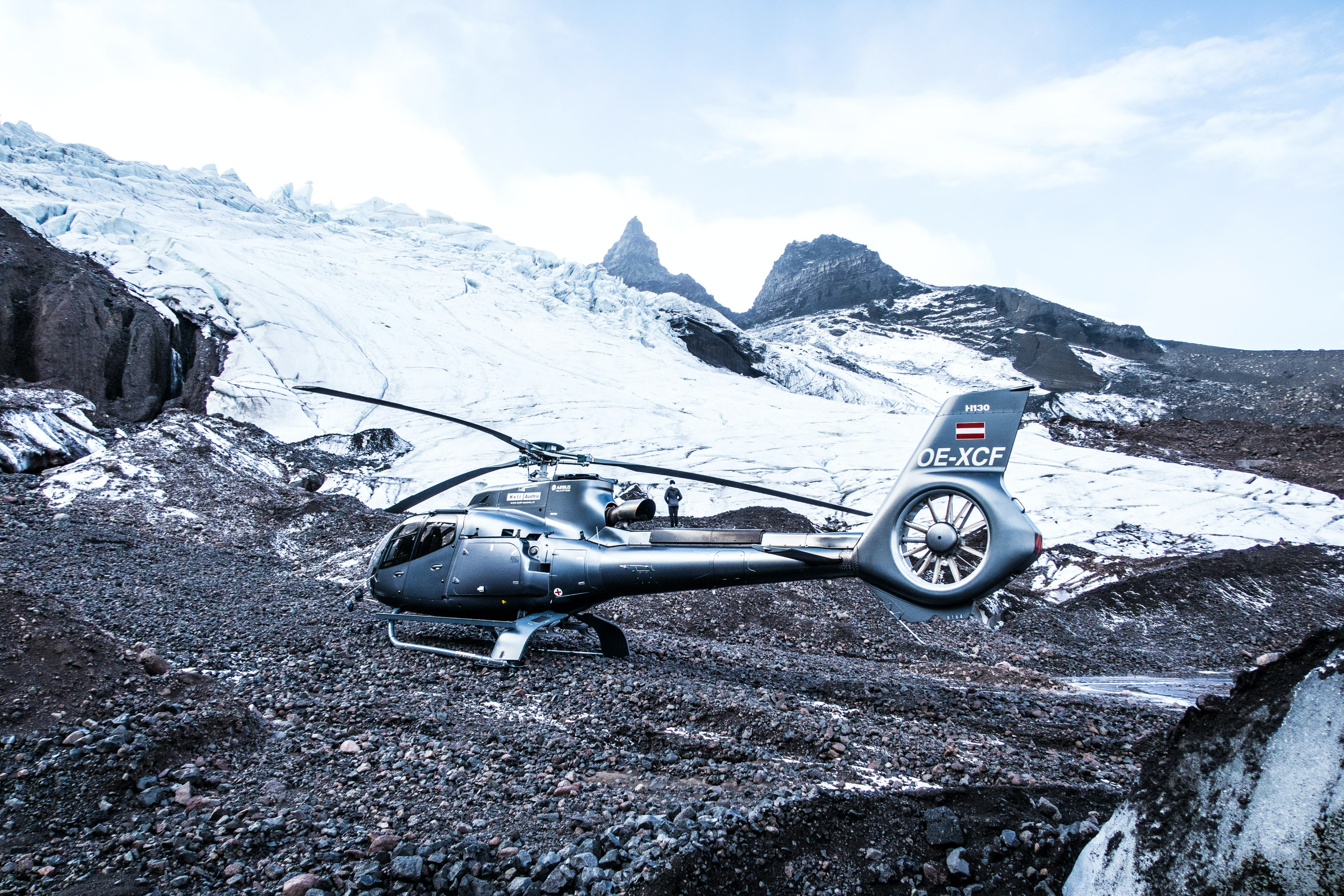 A helicopter on a glacier landing tour