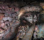 A path meanders down Raufarholshellir cave.
