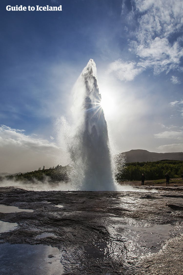 Ready for an eruption, Strokkur - the main attraction in the Geysir Geothermal Area - bubbles and seethes.