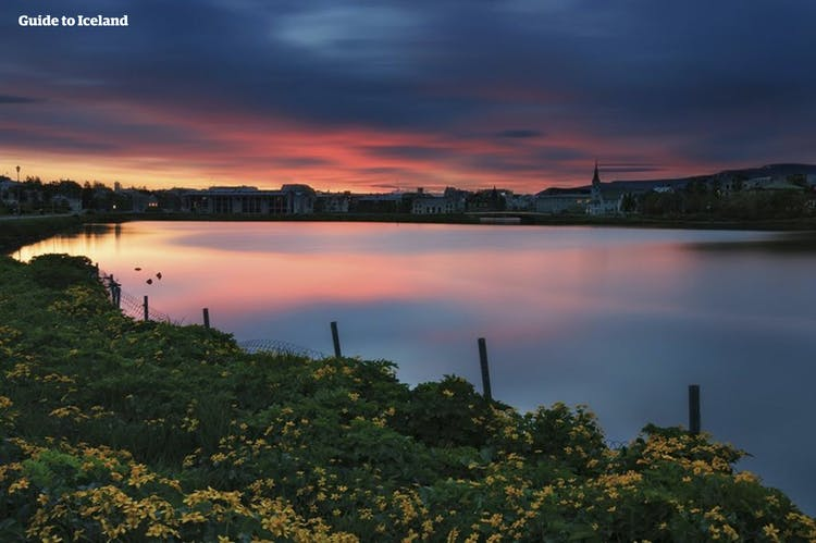 A magnificent sunset over the charming city of Reykjavík.